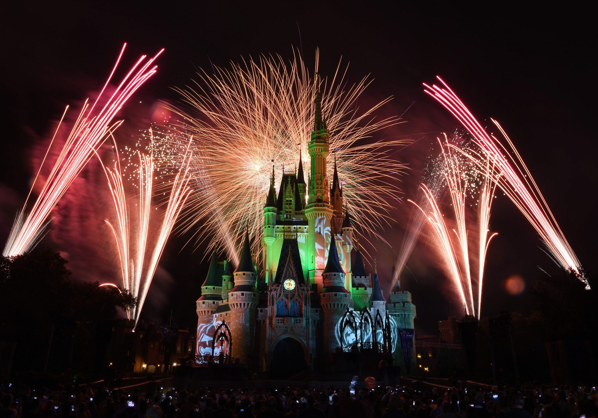 "Orange fireworks explode over Cinderella Castle while illuminated pumpkins are projected with light during the ""Happy HalloWishes"" fireworks show at MickeyÕs Not-So-Scary Halloween Party. The family-friendly after-hours event offers trick-or-treating, meet and greets with favorite characters in costume, plus the must-see ""Mickey's Boo-to-You Halloween Parade"" and ""Happy HalloWishes"" fireworks display. Mickey's Not-So-Scary Halloween Party is a special ticket event and takes place on select nights each fall at Walt Disney World Resort in Lake Buena Vista, Fla. (Todd Anderson, photographer)"