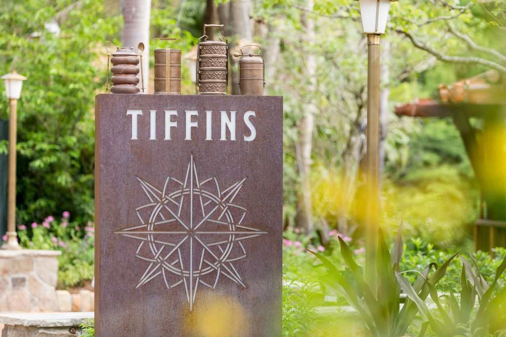 "Tiffins, a new restaurant at Disney's Animal Kingdom celebrates the art of traveling and includes the adjoining Nomad Lounge with waterfront views with outdoor seating. Open for both lunch and dinner, Tiffins' menu features a diverse menu drawing from places that inspired the creation of Disney's Animal Kingdom. The Indian English word ""tiffin"" means a midday meal or type of container used to carry food while traveling. (Scott Watt, photographer)"